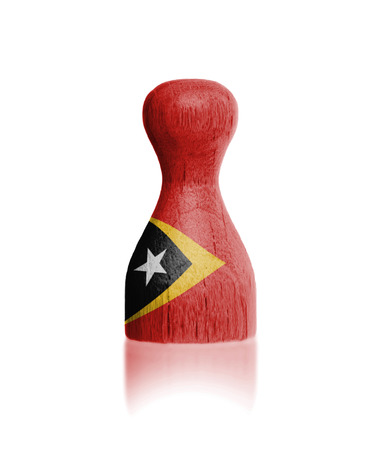 timor: Wooden pawn with a painting of a flag, East Timor