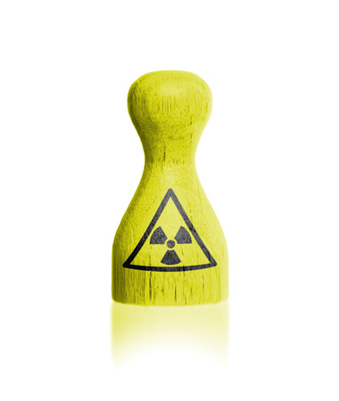 boardgames: Wooden pawn with a painting, danger - radiation Stock Photo