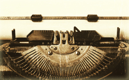 Close-up of an old typewriter with paper, vintage look
