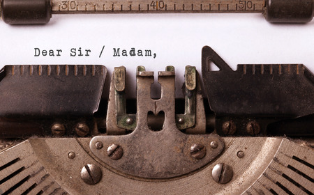 madam: Vintage inscription made by old typewriter, dear sir madam Stock Photo