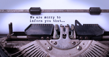 apologise: Vintage inscription made by old typewriter, sorry to inform you that