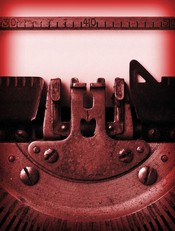 Detail of an old typewriter, bright red photo