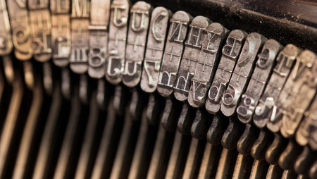 Close-up of an old retro typewriter with paper, warm photo