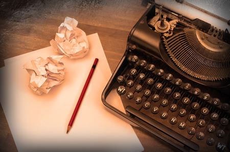 Close-up of an old typewriter with paper, vintage look, warm photo