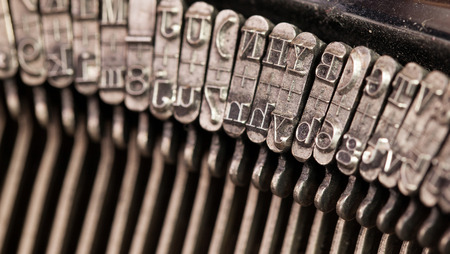 Close-up of an old retro typewriter with paper, natural colors photo