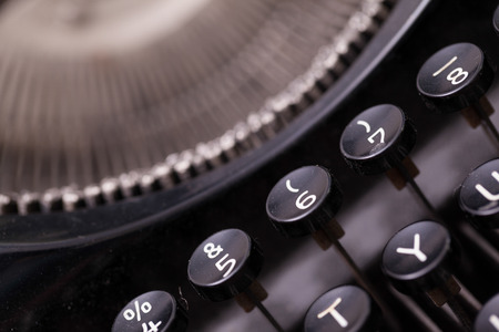 Close up photo of antique typewriter keys, shallow focus, natural colors photo