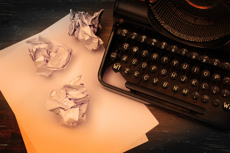 Close-up of an old typewriter with paper, vintage look photo