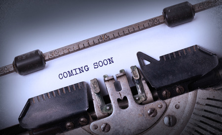 Vintage inscription made by old typewriter, coming soon photo