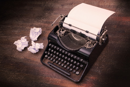 Vintage typewriter on wooden table, touch-up in retro style Stock Photo