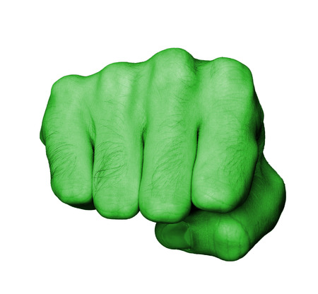 Very hairy knuckles from the fist of a man punching, green skin photo