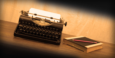 Vintage typewriter and old books, touch-up in retro style photo