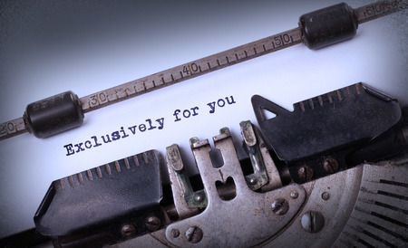 exclusively: Vintage inscription made by old typewriter, exclusively for you Stock Photo