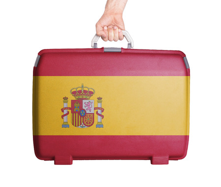 Used plastic suitcase with stains and scratches, printed with flag, Spain