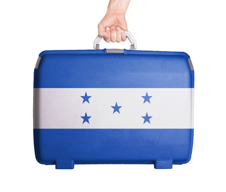 flag of honduras: Used plastic suitcase with stains and scratches, printed with flag, Honduras