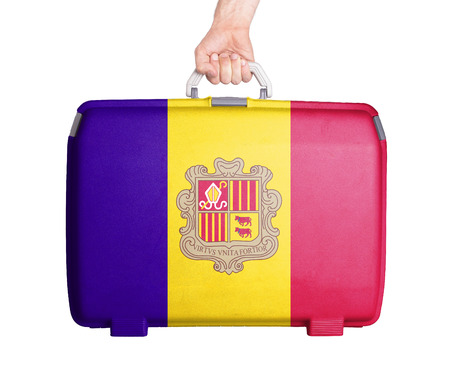 tourism in andorra: Used plastic suitcase with stains and scratches, printed with flag, Andorra