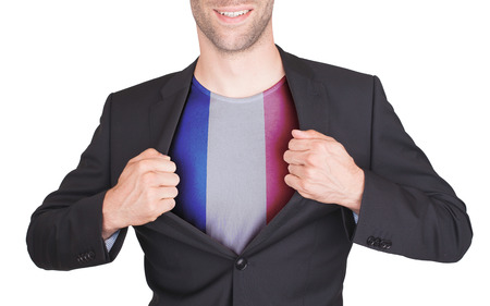 Businessman opening suit to reveal shirt with flag, France photo