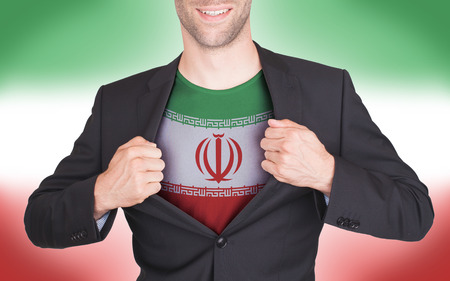 Businessman opening suit to reveal shirt with flag, Iran photo