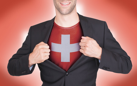 Businessman opening suit to reveal shirt with flag, Switzerland photo