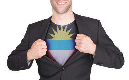 Businessman opening suit to reveal shirt with flag, Antigua and Barbuda photo