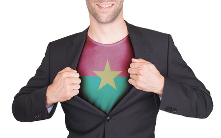 Businessman opening suit to reveal shirt with flag, Burkina Faso photo