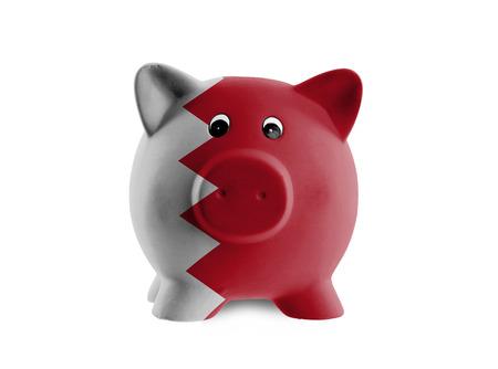 bahrain money: Unique pink ceramic piggy bank isolated on white, Bahrain