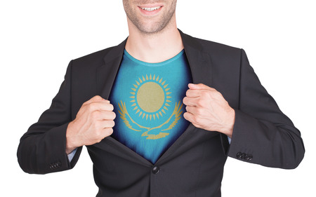 Businessman opening suit to reveal shirt with flag, Kazakhstan photo