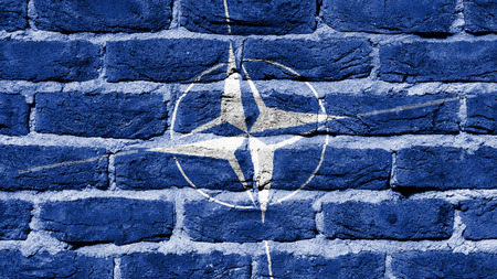 broken unity: Very old brick wall texture, NATO painting