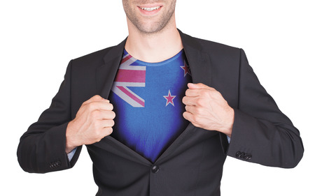flag of new zealand: Businessman opening suit to reveal shirt with flag, New Zealand Stock Photo