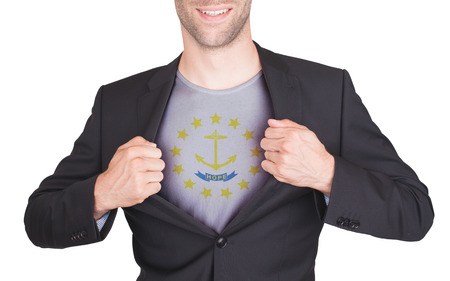 Businessman opening suit to reveal shirt with state flag (USA), Rhode Island photo