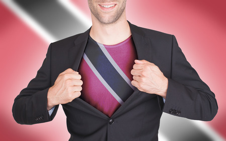 Businessman opening suit to reveal shirt with flag, Trinidad and Tobago photo