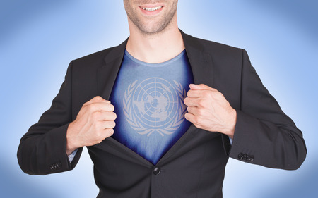 united nations: Businessman opening suit to reveal shirt with flag, United Nations Stock Photo