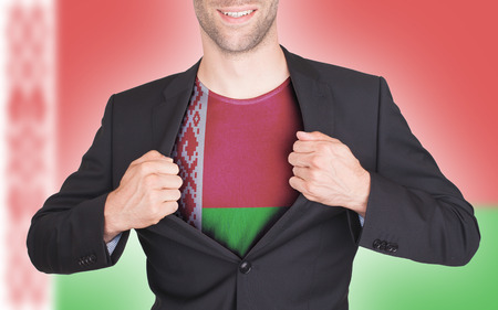 Businessman opening suit to reveal shirt with flag, Belarus photo