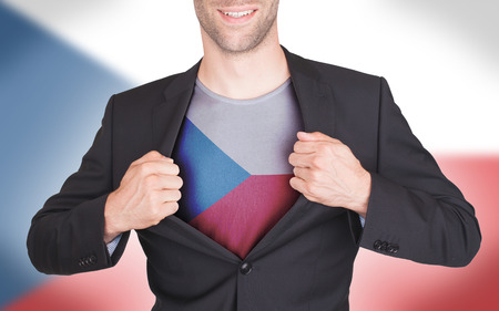 Businessman opening suit to reveal shirt with flag, Czech Republic photo