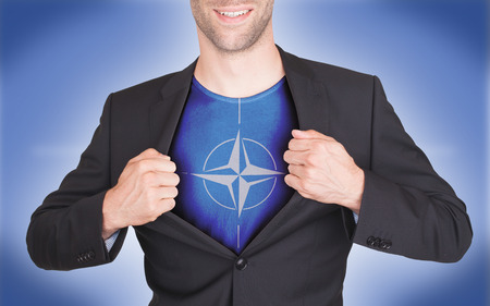reveal: Businessman opening suit to reveal shirt with flag, NATO
