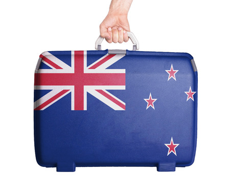 flag of new zealand: Used plastic suitcase with stains and scratches, printed with flag, New Zealand