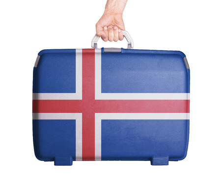 the icelandic flag: Used plastic suitcase with stains and scratches, printed with flag, Iceland