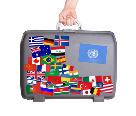 united nations: Used plastic suitcase with lots of small stickers, large sticker of the United Nations Stock Photo