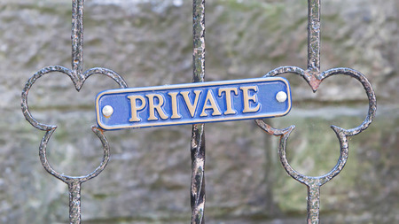 Old private sign on a metal gate photo