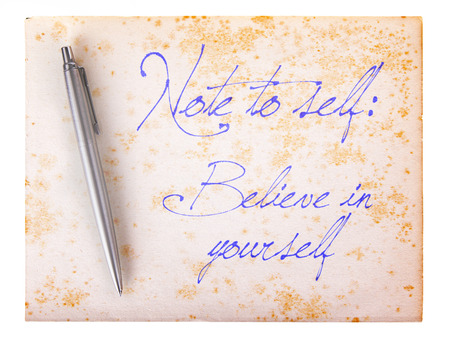 believing: Old paper grunge background, white and brown - Believe in yourself Stock Photo