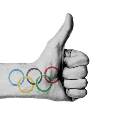olympic rings: Closeup of male hand showing thumbs up sign against white background, olympic rings