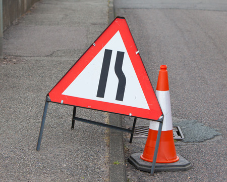 roadwork: Roadwork sign at the side of a road Stock Photo