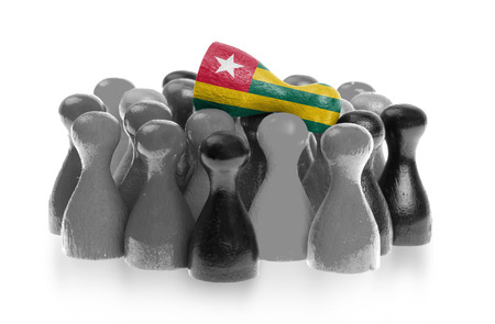 One unique pawn on top of common pawns, flag of Togo photo