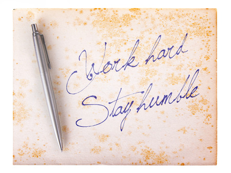 stylo: Old paper grunge background, white and brown - Work hard, stay humble Stock Photo
