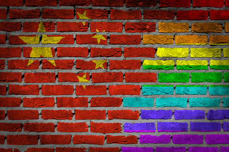 lesbo: Dark brick wall texture - coutry flag and rainbow flag painted on wall -