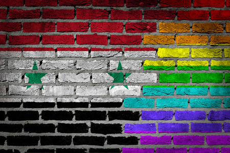 lesbo: Dark brick wall texture - coutry flag and rainbow flag painted on wall - Syria Stock Photo
