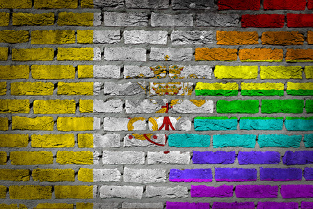 lesbo: Dark brick wall texture - coutry flag and rainbow flag painted on wall - Vatican