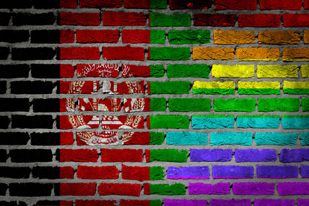 afghan flag: Afghanistan coutry flag and rainbow flag painted on wall