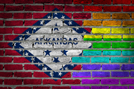 lesbo: Arkansas country flag and rainbow flag painted on wall Stock Photo