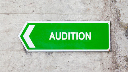 audition: Green sign on a concrete wall - Audition
