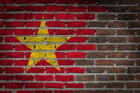 Dark brick wall texture - flag painted on wall - Vietnam photo